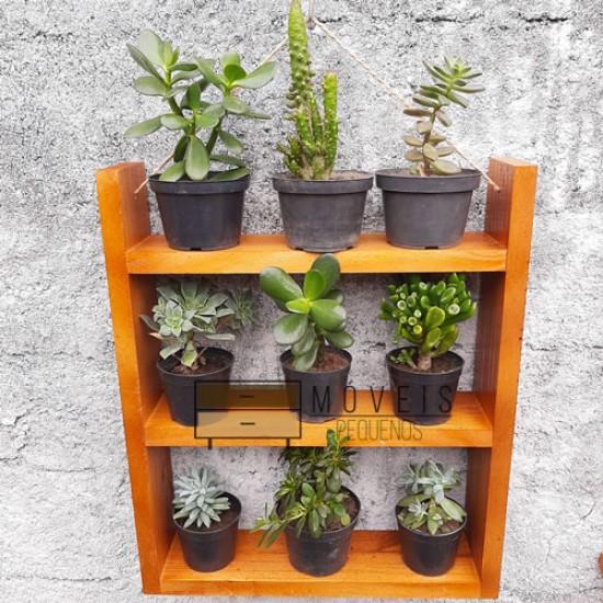 Prateleira  objeto de decoração e plantas